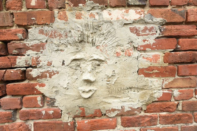 This rough-hewn mortar face was likely done on a whim, but it's been on this alley wall since at least the early 1990s, when the building was home to a gay nightclub called Mickey Ratz.
