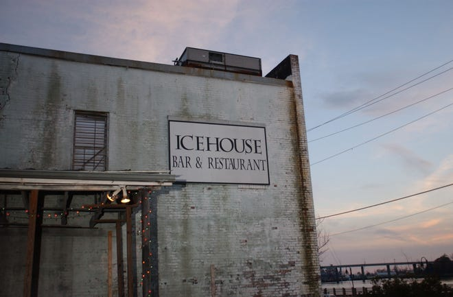 The setting sun colors the sky behind the IceHouse Bar in downtown Wilmington in February 2004.  The building that housed the bar was torn down later that year.