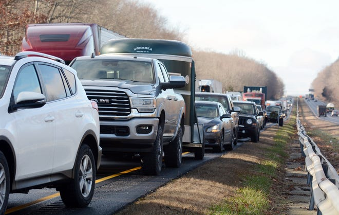 Traffic backs up as several local fire departments respond to a tire fire in a trailer truck tire fire Monday morning on I-395 in Norwich.