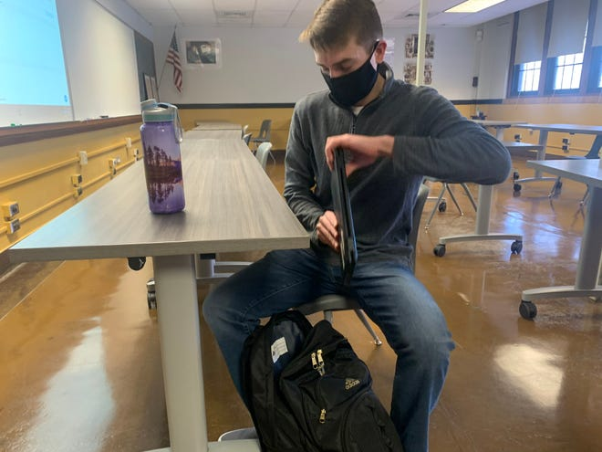 Kelm Lear, a senior at Topeka High School, prepares for class. Lear is a community service leader not just in the school but in the broader community.