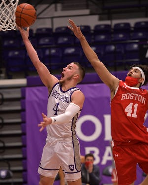 Austin Butler, shown hitting a layup in Monday's season opener against Boston University, had 18 points for the Crusaders in a win over the Terriers on Tuesday.