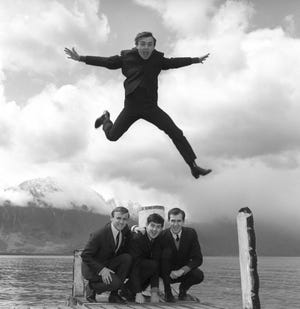 "In this April 25, 1964 photo, Gerry Marsden leaps over his band, the Pacemakers. Marsden, the British singer and lead singer of Gerry and the Pacemakers, who was instrumental in turning a song from the Rodgers and Hammerstein musical ""Carousel"" into one of the great anthems in the world of football, has died."