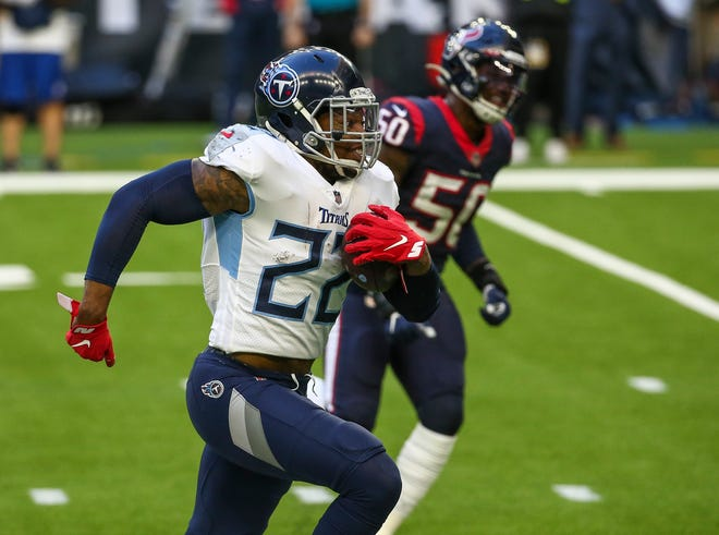 Titans running back Derrick Henry (22) is on the move during the second half against the Texans.