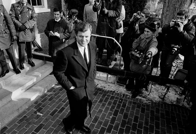 Sen. Edward Kennedy, D-Mass., smiles as he leaves Duke County Courthouse in Edgartown, during a recess in the inquest into the death of Mary Jo Kopechne, Jan. 5, 1970. Kopechne drowned when a car driven by Kennedy plunged off a bridge on Chappaquiddick, a small island on the eastern end of Martha's Vineyard.