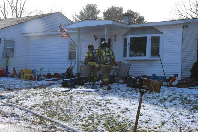Firefighters at scene of Oxford house fire Monday afternoon.