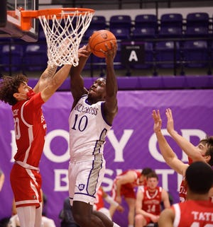Gerrale Gates (10) had 22 points and 11 rebounds Sunday in Holy Cross' men's basketball loss at Colgate.