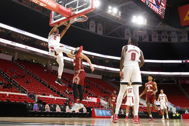 Freshman guard Shakeel Moore (2) is thriving on the court for the Wolfpack this season. He's averaging 14.5 points and two steals over his last two games.