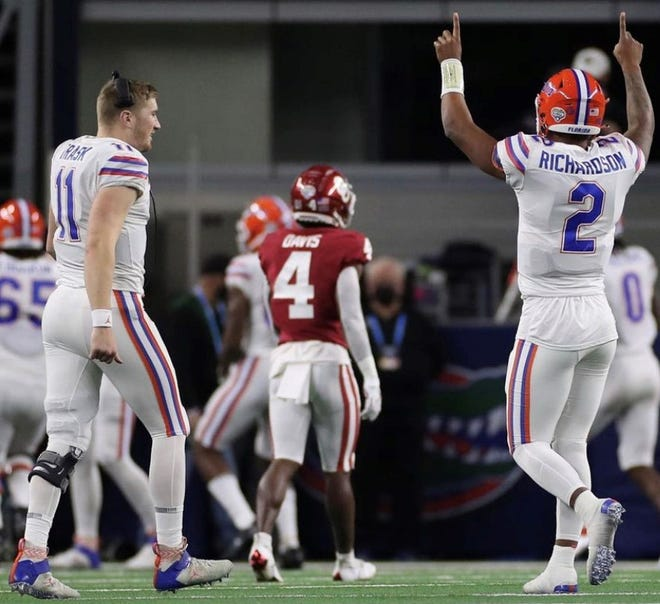 Florida quarterback Kyle Trask, left, is one of four finalist for the 2020 Heisman Trophy, which is awarded annually to the most outstanding player in college football.