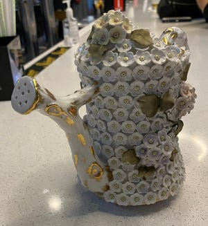 This porcelain watering can may have been made in England about 100 years ago. [Submitted photo]