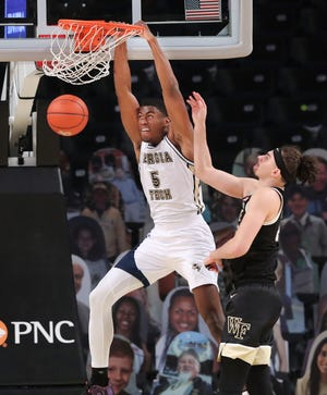 Georgia Tech forward Moses Wright dunks past Wake Forest's Ismael Massoud, right, in Sunday night's game.