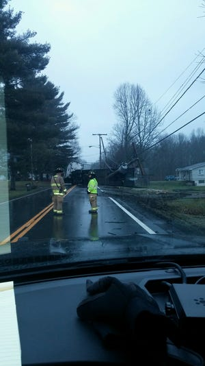 A truck has hit a power pole on state Route 800, closing the road in Dennison.
