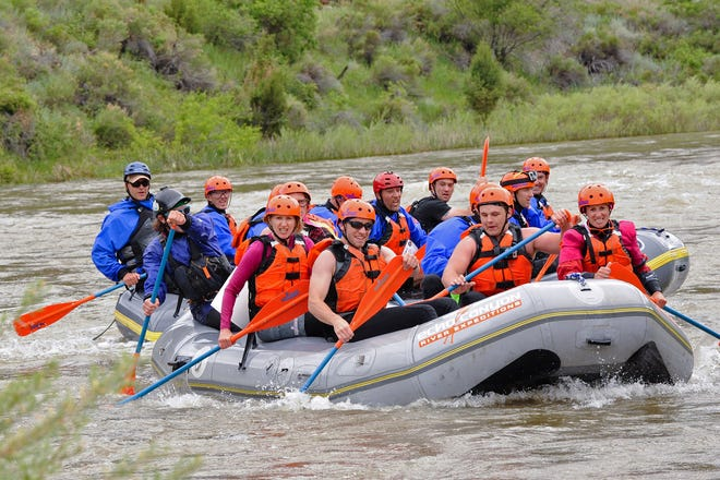 Two teams jockey for the lead in the Battle of the Bighorn's rafting challenge.