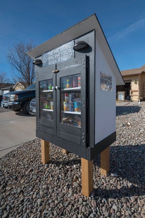 A 'Blessing Box' sits in front of the home of GT Davis in Pueblo West.