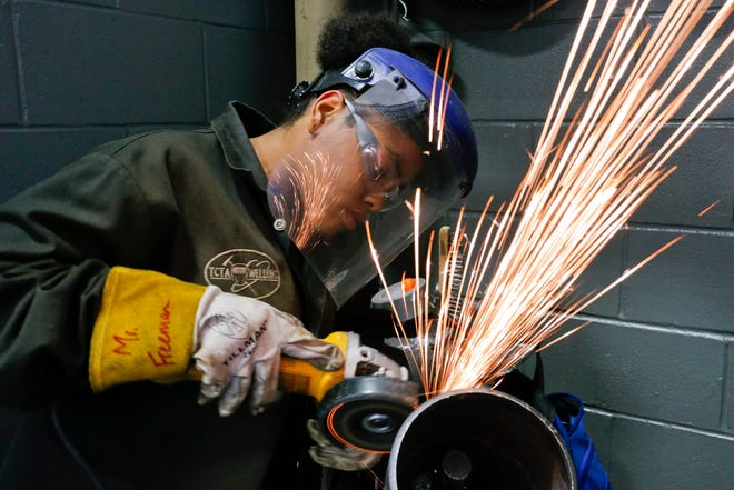Megan Coleman grinds a weld and makes the sparks fly during a class at Tuscaloosa Career and Technology Academy on Tuesday, March 26, 2019.  [Staff Photo/Gary Cosby Jr.]