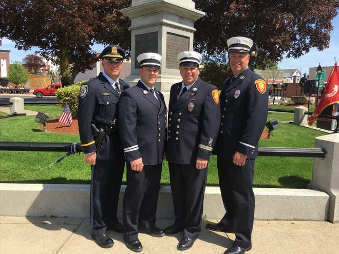 From left to right, Thomas Browne, Deputy Chief, Burlington Police Department; Captain Timothy Browne, Burlington Fire Department,  Captain Kevin Browne, Burlington Fire Department and  Captain James Browne, Burlington Fire Department.