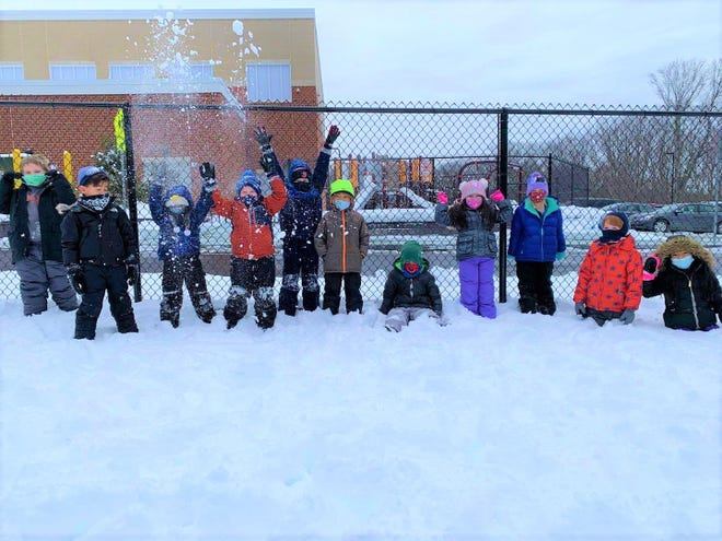 First-graders at the Goodnow Brothers Elementary School in Marlborough enjoy the recent snowfall.