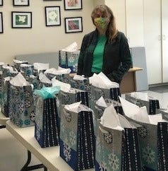 Pictured: Debra Galloway, director of the Sudbury Senior Center, gave away holiday gift bags on Dec. 22. Shout out to the Senior Center staff and their sponsors: Bridges by Epoch of Sudbury Memory Care and the Friends of Sudbury Seniors for helping to spread some holiday joy!