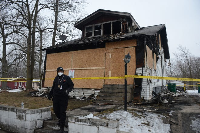 Battle Creek Fire Marshal Quincy Jones on Monday leaves the Oneita Street house which burned Sunday morning, killing one man. Jones is continuing his investigation into the cause of the fire.