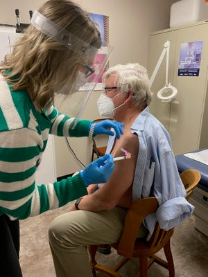 Tammy Smith, the director of nursing at the Coshocton County Health Department, recently administered one of the first does of the COVID-19 vaccine in Coshocton County to Dr. Robert Gwinn. Several local elected officials said they would get the vaccine when made available to them.