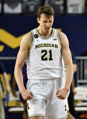 Guard Michigan Franz Wagner (21) bereaksi di babak kedua.
