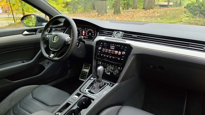 The interior of the 2020 VW Arteon is not quite as stylish as the car's ambitious exterior, but the digital screens and ready knobs make for easy usability.