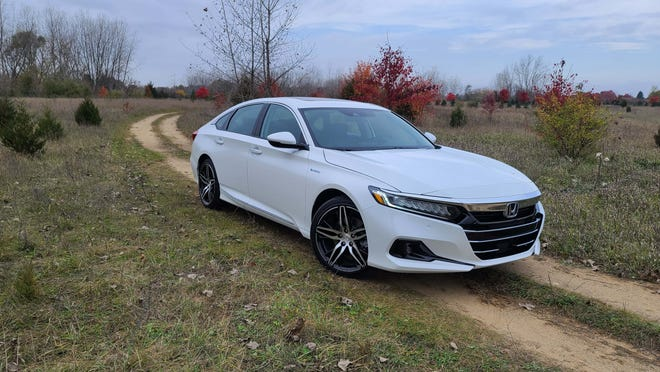 The 2021 Honda Accord Hybrid is a sleek, mainstream sedan with many of the same amenities as luxury cars costing thousands more. The hybrid starts at about $1,500 more than a gas-powered Accord. This loaded Touring model lists for $36,795.