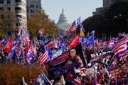 In this Nov. 14, 2020, file photo with the U.S. Capitol in the background, supporters of President Donald Trump rally at Freedom Plaza in Washington.