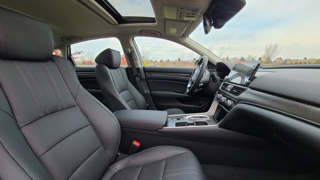 The comfortable, quiet interior of the 2021 Honda Accord Hybrid features optional leather seats and sunroof. Console ergonomics are excellent for storage and usability.