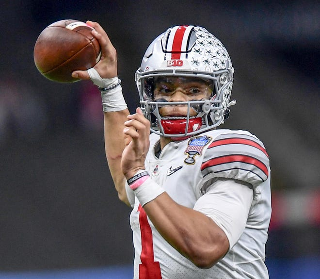 Ohio State quarterback Justin Fields(1) throws during the second quarter of the College Football Playoff Semifinal  Jan 1, 2021; New Orleans, La  USA;  at Mercedes-Benz Superdome. (Ken Ruinard-USA TODAY Sports)