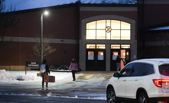 Students enter Leslie High School Monday morning, Jan. 4, 2021, for the opening day of in-person classes since the Nov. 18 state-mandated closure of face-to-face classes due to the COVID-19 pandemic.