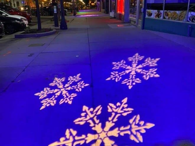 Downtown Lansing, Inc. is raising money to install colorful lights at Washington Square in Lansing. These snowflakes were projected in November 2019, while local leaders were testing lighting out the plan.