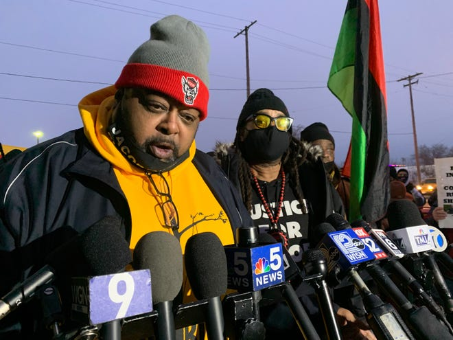 Jacob Blake's father, Jacob Blake Sr., left, speaks at a news  conference calling for charges against Officer Rusten Sheskey on Monday, Jan. 4, 2021. At right is Justin Blake, Jacob Blake's uncle.