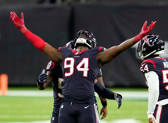 Houston Texans defensive end Charles Omenihu celebrates after sacking Tennessee Titans quarterback Ryan Tannehill during the teams' match up earlier this month.
