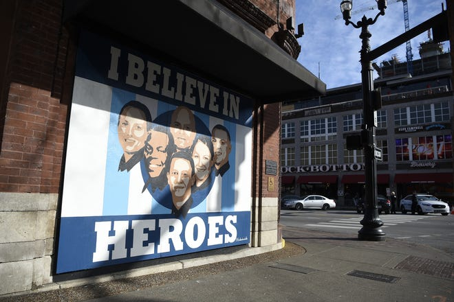 "The ""I Believe in Heroes"" mural honors six Metro police officers who helped save and evacuate the people at Second Avenue North before a Christmas day bombing in Nashville."