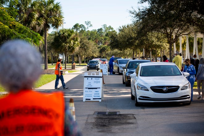 Cars park at vaccine stations during a COVID-19 vaccine distribution run by the Collier Department of Health at North Collier Regional Park on Monday, January 4, 2021.