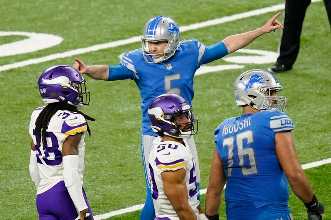 Detroit Lions kicker Matt Prater (5) reacts after successfully kicking at 54-yard field goal during the first half of an NFL football game against the Minnesota Vikings on Sunday in Detroit.