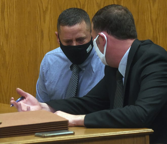 Former Zanesville police sergeant Jarred A. Miracle, 40, consults with defense attorney Derrick Moorehead during a change of plea hearing on Monday, Jan. 4, 2021. Miracle plead ed guilty to one count each improper handling of a firearm in a motor vehicle, a fourth-degree felony, and operating a vehicle while under the influence, a first-degree misdemeanor.