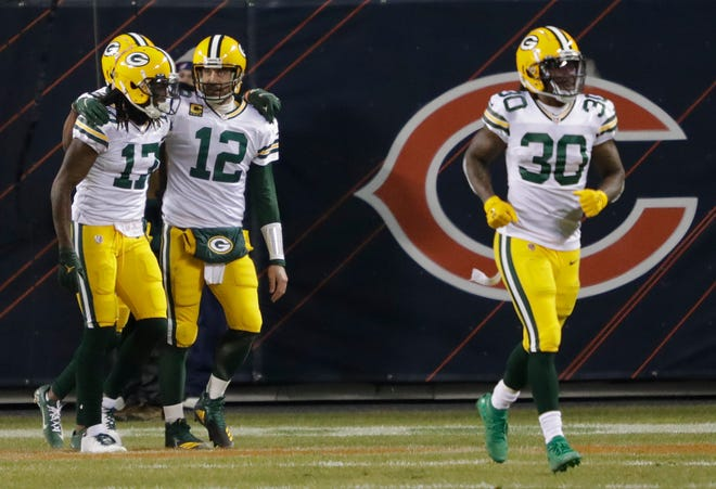 Green Bay Packers wide receiver Davante Adams (17) and quarterback Aaron Rodgers (12) celebrate a fourth quarter touchdown score against the Chicago Bears during their football game Sunday, Jan. 3, 2021, at Soldier Field in Chicago, Ill.  Dan Powers/USA TODAY NETWORK-Wisconsin