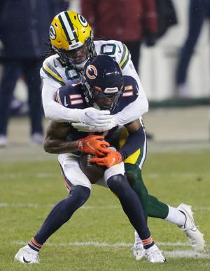 Green Bay Packers cornerback Kevin King (20) tackles Chicago Bears wide receiver Darnell Mooney (11) during their football game Sunday, January 3, 2021, at Soldier Field in Chicago, Ill.