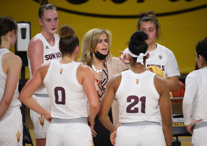 Arizona State head coach Charli Turner Thorne talks to her players during Pac-12 play against Stanford in Tempe Jan. 3, 2021.