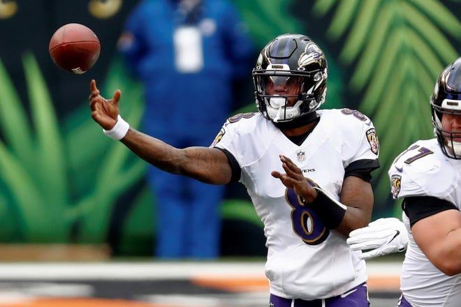 Baltimore Ravens quarterback Lamar Jackson (8) passes against the Cincinnati Bengals during the first half of an NFL football game, Sunday, Jan. 3, 2021, in Cincinnati. (AP Photo/Aaron Doster)