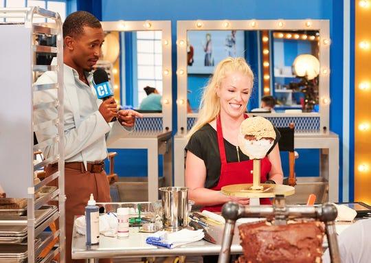 Judge Kalen Allen interviewing contestants Sara Bunton Powell as she builds her cake, as seen on Cake -A-Like season 1.