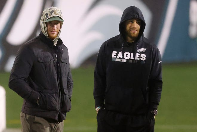 Philadelphia Eagles' Carson Wentz and Zach Ertz stand on the field hours after the Eagles lost to the Washington Football Team 20-14 in an NFL football game, Sunday, Jan. 3, 2021, in Philadelphia. (AP Photo/Rich Schultz)