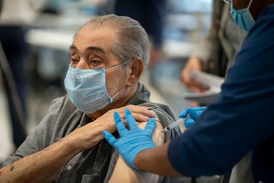 COVID-19 vaccination on Dec. 30, 2020, in Delray Beach, Florida.
