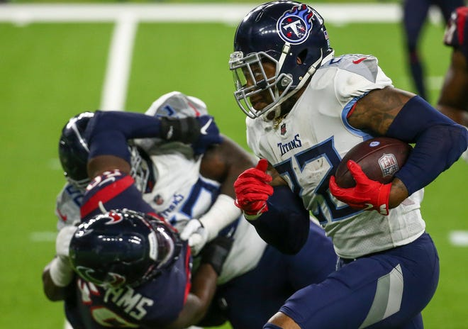 The Tennessee Titans' Derrick Henry topped 2,000 rushing yards during Sunday's win against the Houston Texans.