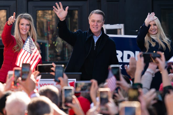 Ivanka Trump, right, joins Republican Sens. Kelly Loeffler and David Perdue of Georgia at a campaign event Dec. 21, 2020, in Milton, Ga.