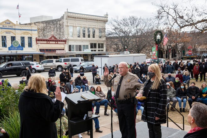 Williamson County Sheriff Mike Gleason raises his hand next to his wife Allison while being sworn in Jan. 1. Gleason has pledged to restore the department's reputation and rebuild badly damaged community trust.