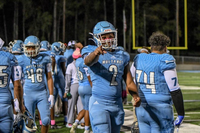 Denzel Moore celebrates after a play during a game near the end of Meadowcreek's season.
