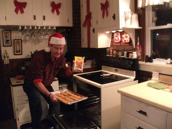 Dave Mikla bakes some Toll House cookies for his 94-year-old mother for Christmas.