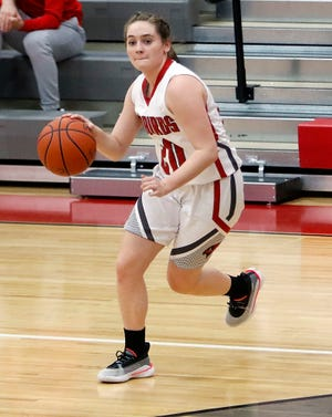 Loudonville's Shalen Guilliams (20) dribbles the ball against North Royalton during high school girls basketball action on Jan. 4, 2021 at Loudonville High School.